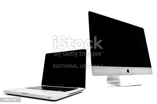 Kampen, The Netherlands - August 20, 2013: Apple iMac desktop computer and Macbook Pro notebook computer, isolated on a white background. Both computers have a blank screen.