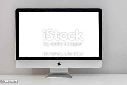 Canakkale, Turkey - June 27, 2018:  Apple iMac 27 inch desktop computer displaying 5k solution White screen with ultra slim design on a Gray background. iMac produced by Apple Inc.