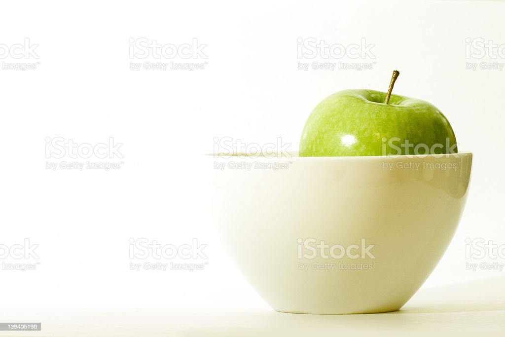 apple in a bowl royalty-free stock photo