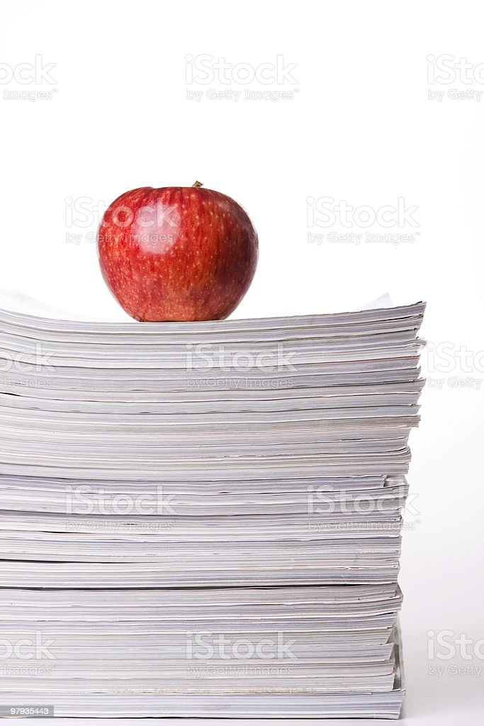 Apple in a stack of books royalty-free stock photo