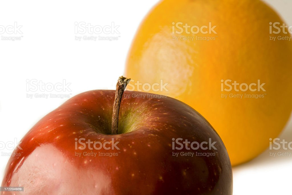 Apple in Front of an Orange stock photo