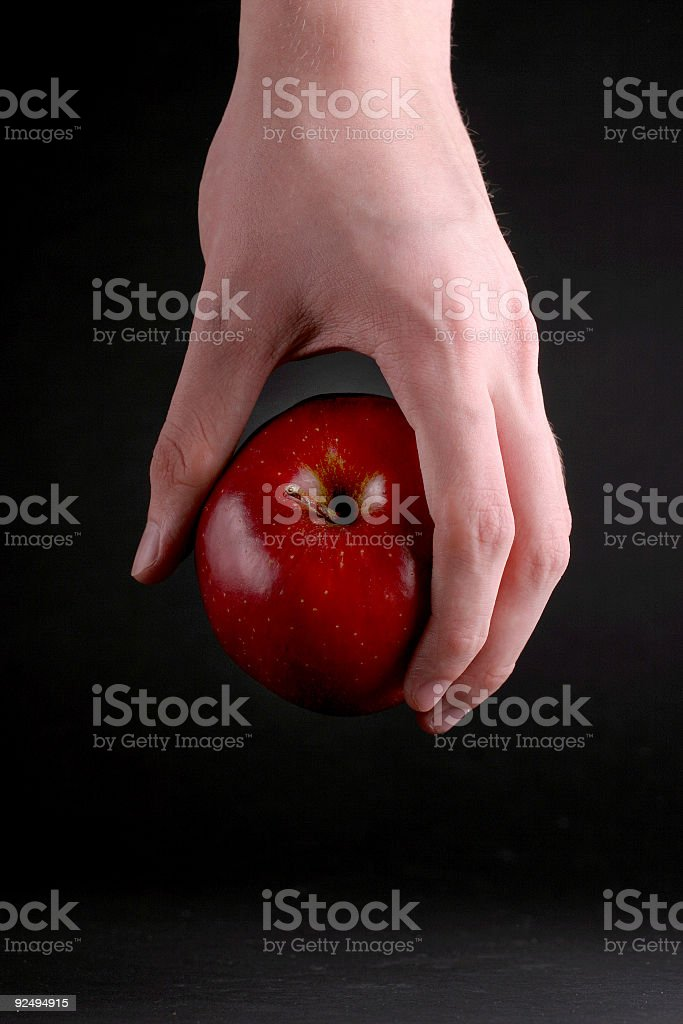 Apple in hand royalty-free stock photo