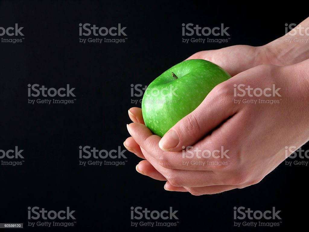 Apple in hands royalty-free stock photo