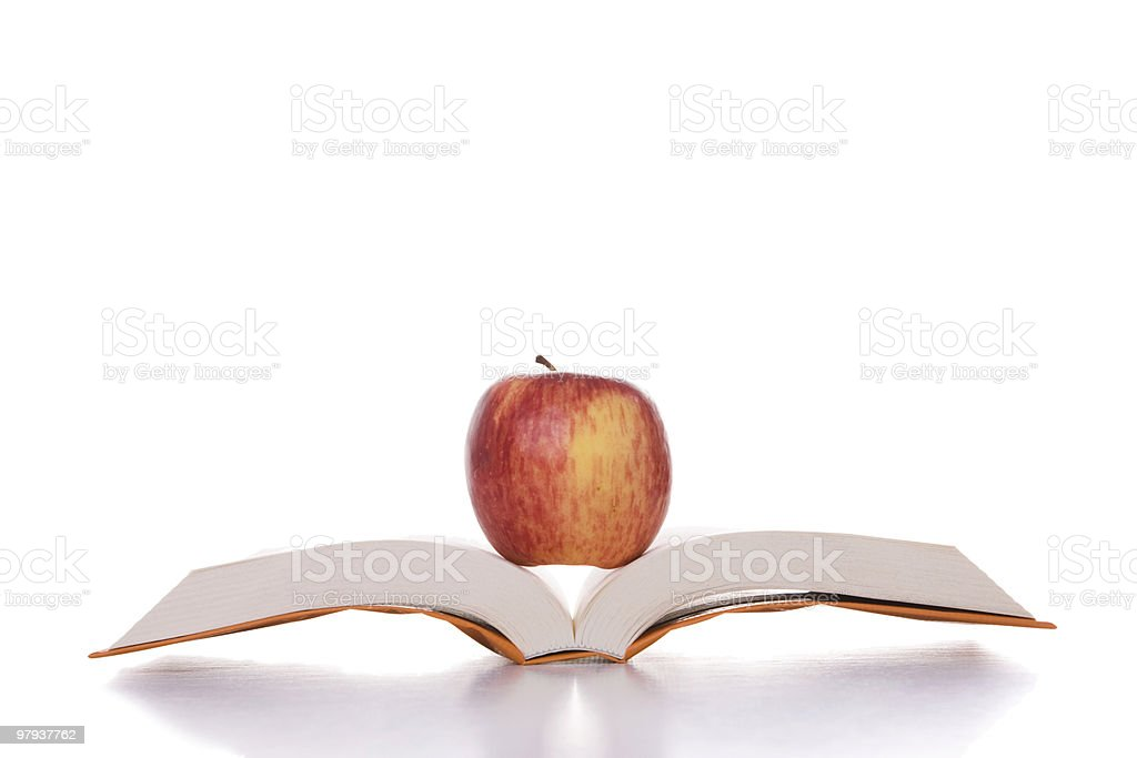 Apple in the book royalty-free stock photo