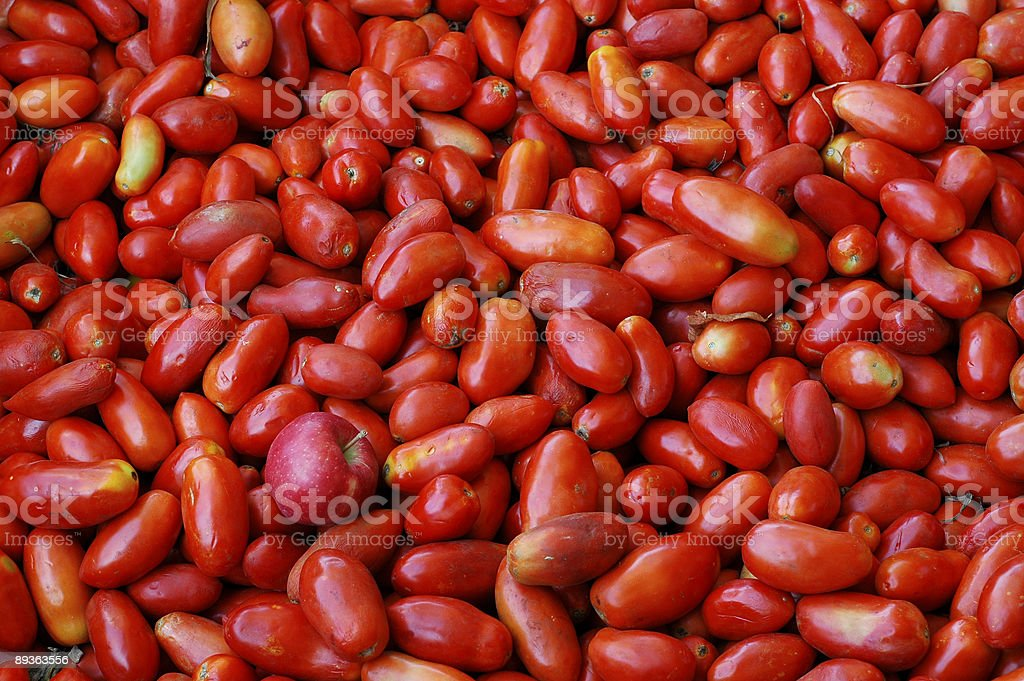 Apple in the tomatoes royalty-free stock photo