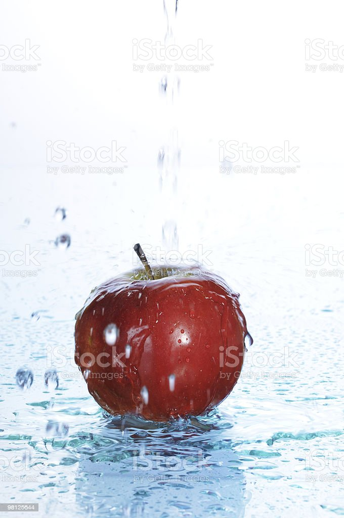 apple in water royalty-free stock photo