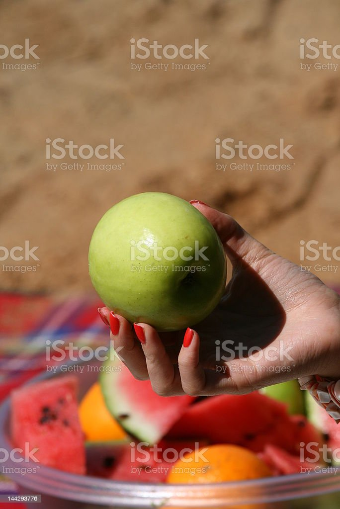 Apple in woman hand royalty-free stock photo