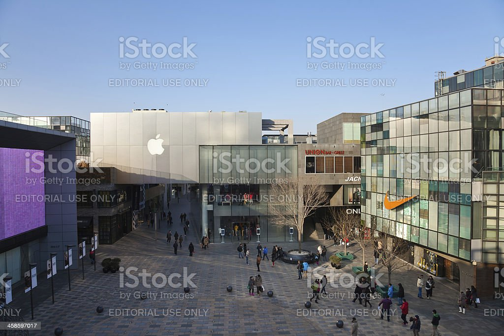 Apple Inc and Nike store in Sanlitun Village royalty-free stock photo