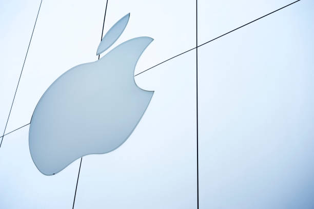 apple inc logo in brushed metal store facade - logo stock photos and pictures