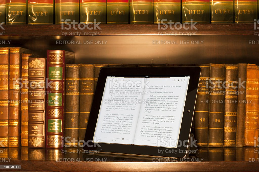 Apple ipad 2 in a library, warm colors stock photo
