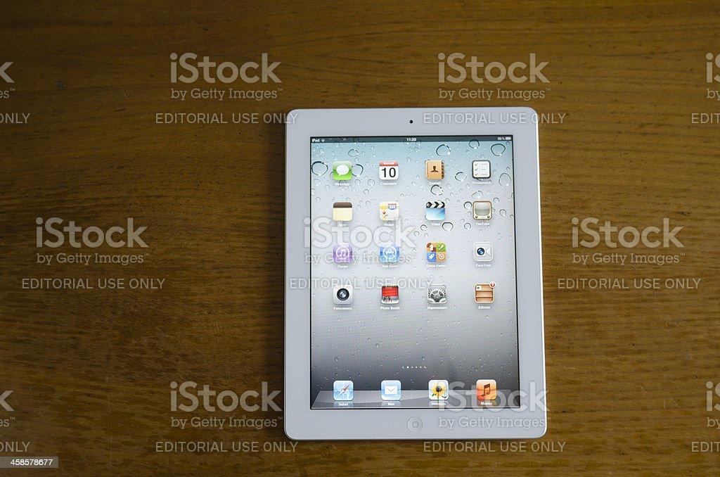 Apple ipad 2 white lying on wood table royalty-free stock photo