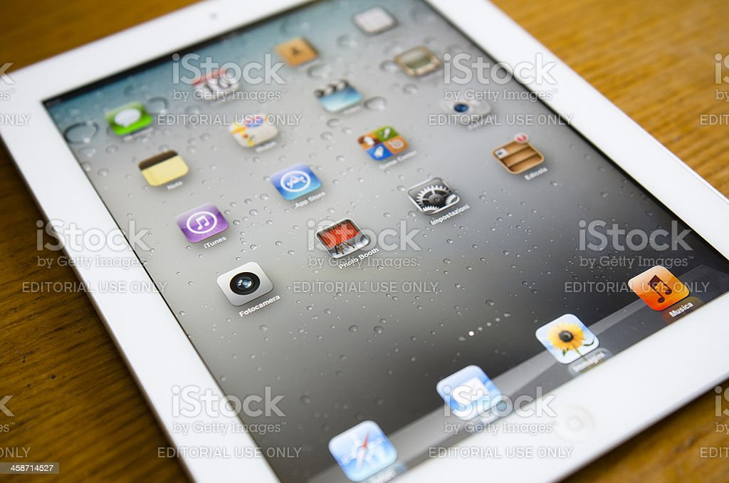 Apple ipad 2 white lying on wood table royalty-free stock photo