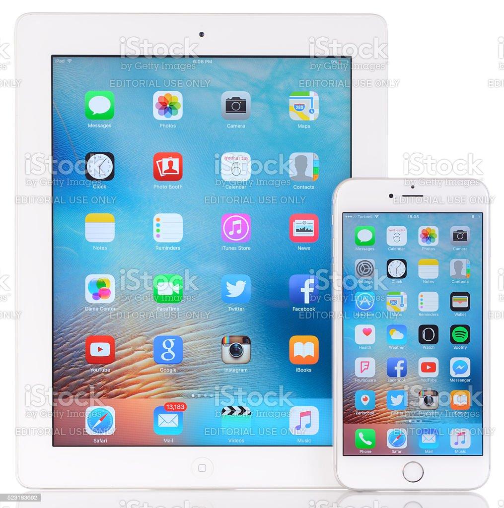 Apple iPad 3 and iPhone 6 plus on white background stock photo