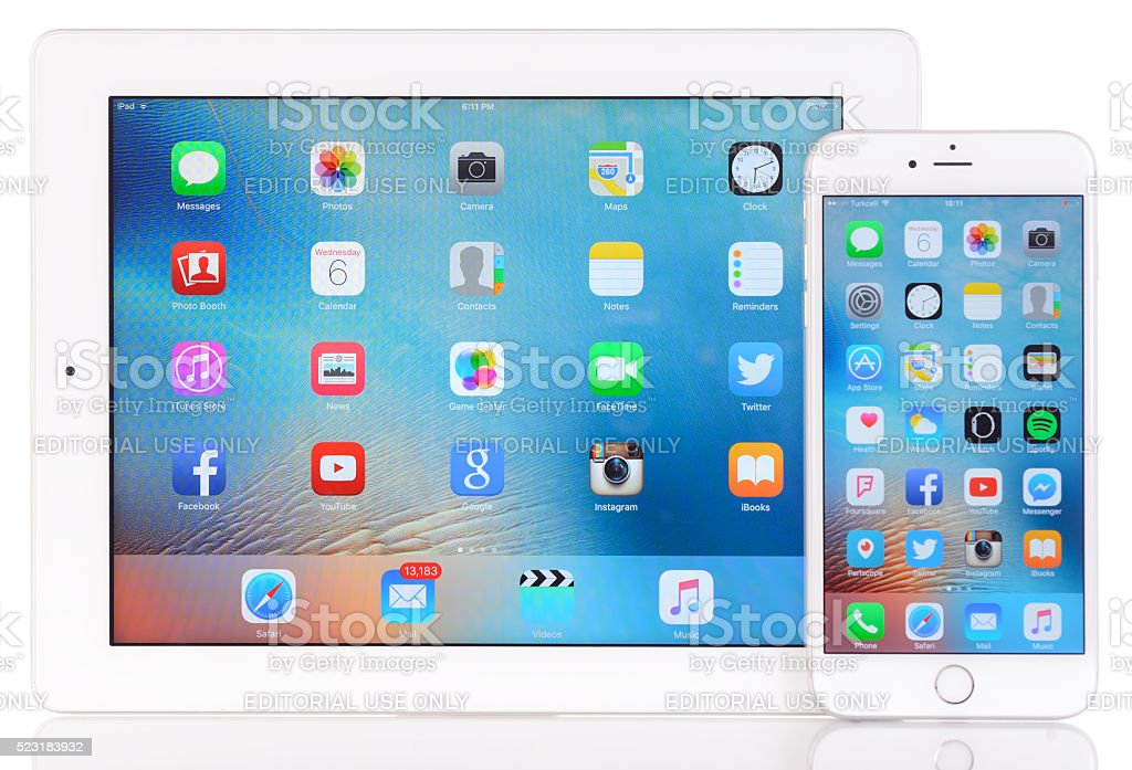 Apple iPad 3 and iPhone 6 plus on white background stock photo