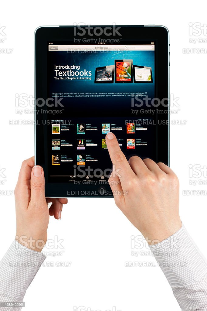 Apple iPad 3G with Textbook royalty-free stock photo