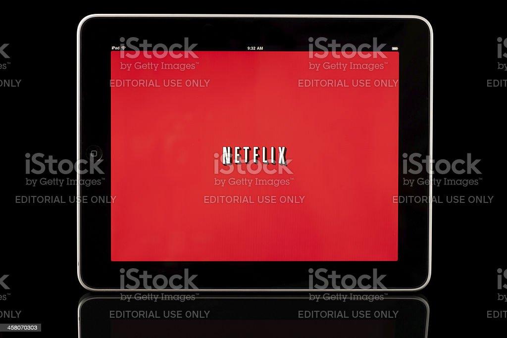 Apple iPad displaying Netflix app, Black with Reflection stock photo