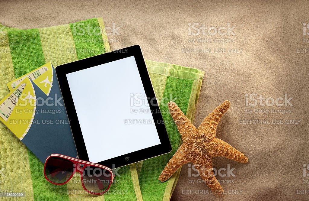 Apple iPad II on the Beach stock photo