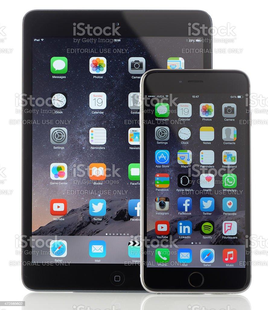 Apple iPad Mini and iPhone 6 Plus on white background stock photo