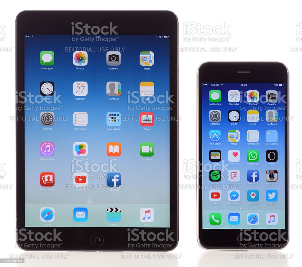 Apple iPad Mini and iPhone 6 Plus on white background stock photo