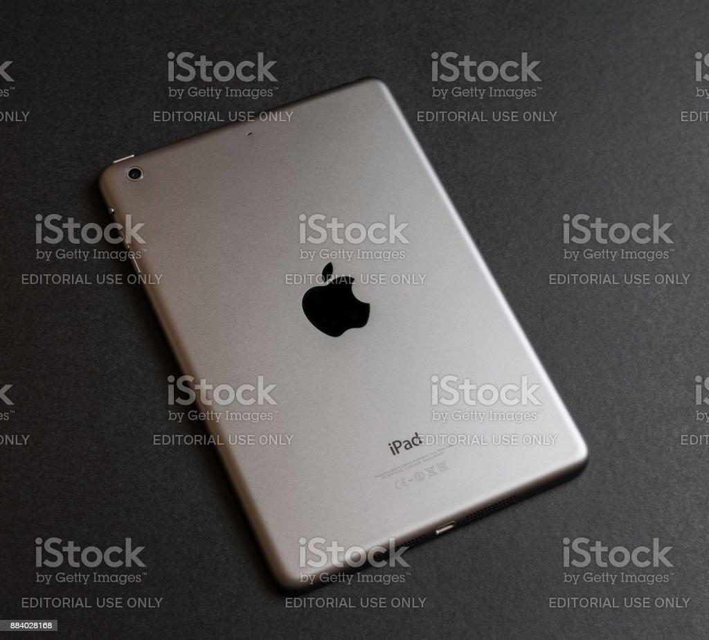 Apple iPad mini on dark backround, backside. stock photo
