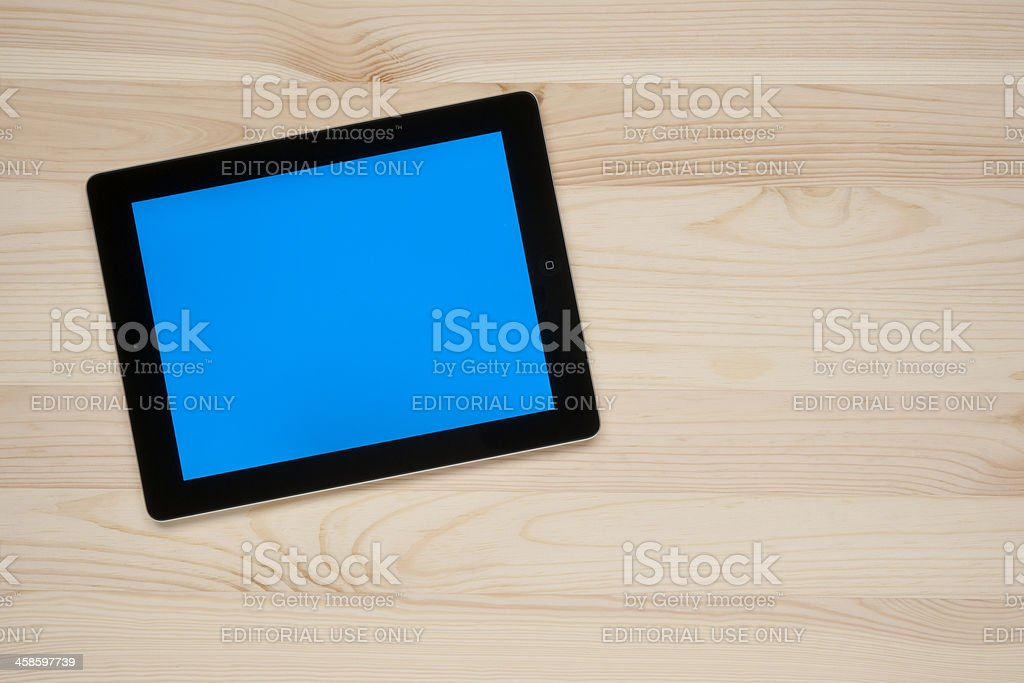 Apple iPad on a worktable royalty-free stock photo