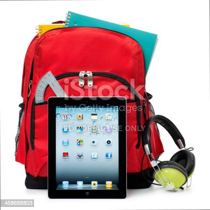 istock Apple iPad on White with a School Backpack 458688803