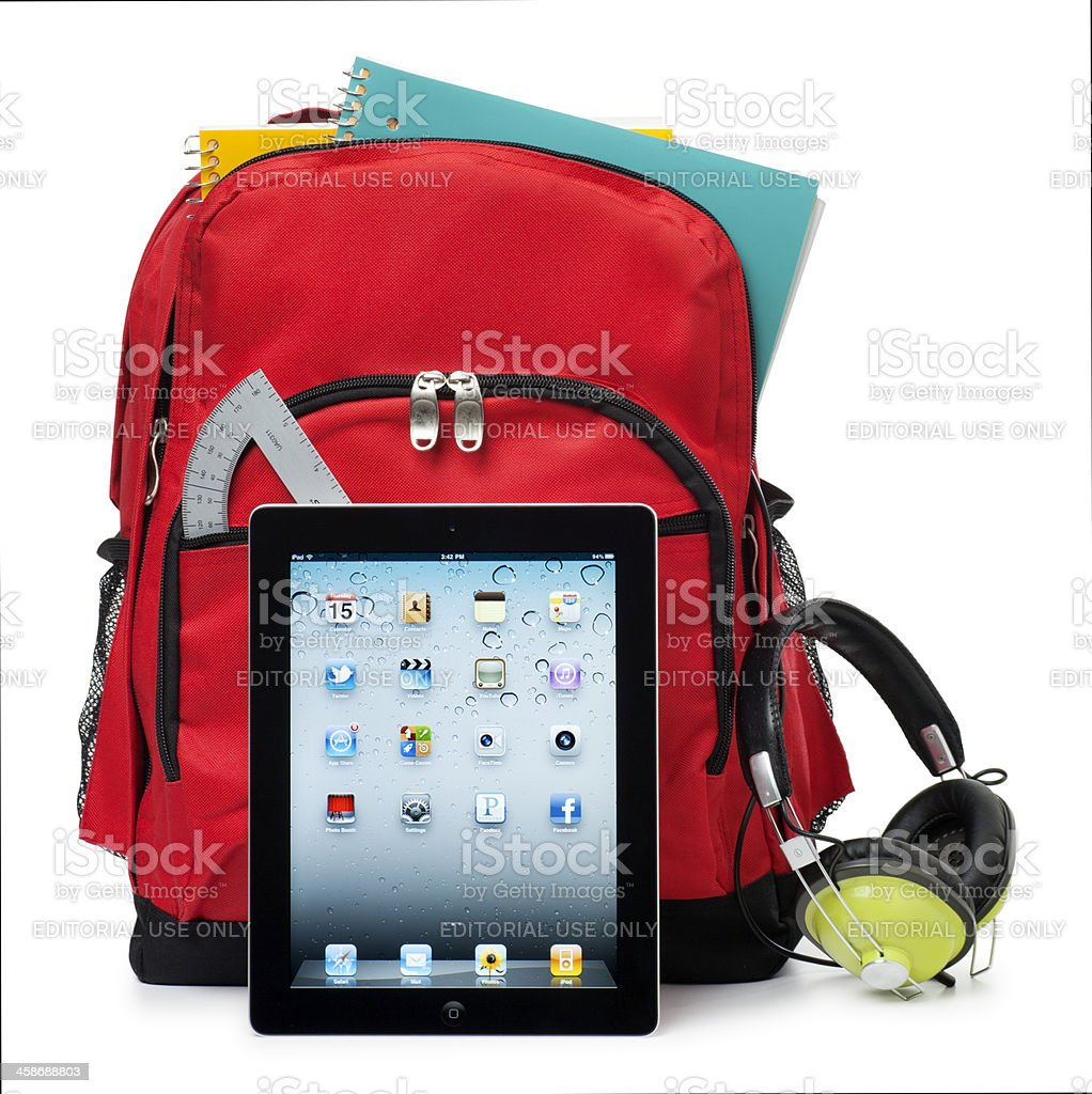 Apple iPad on White with a School Backpack stock photo