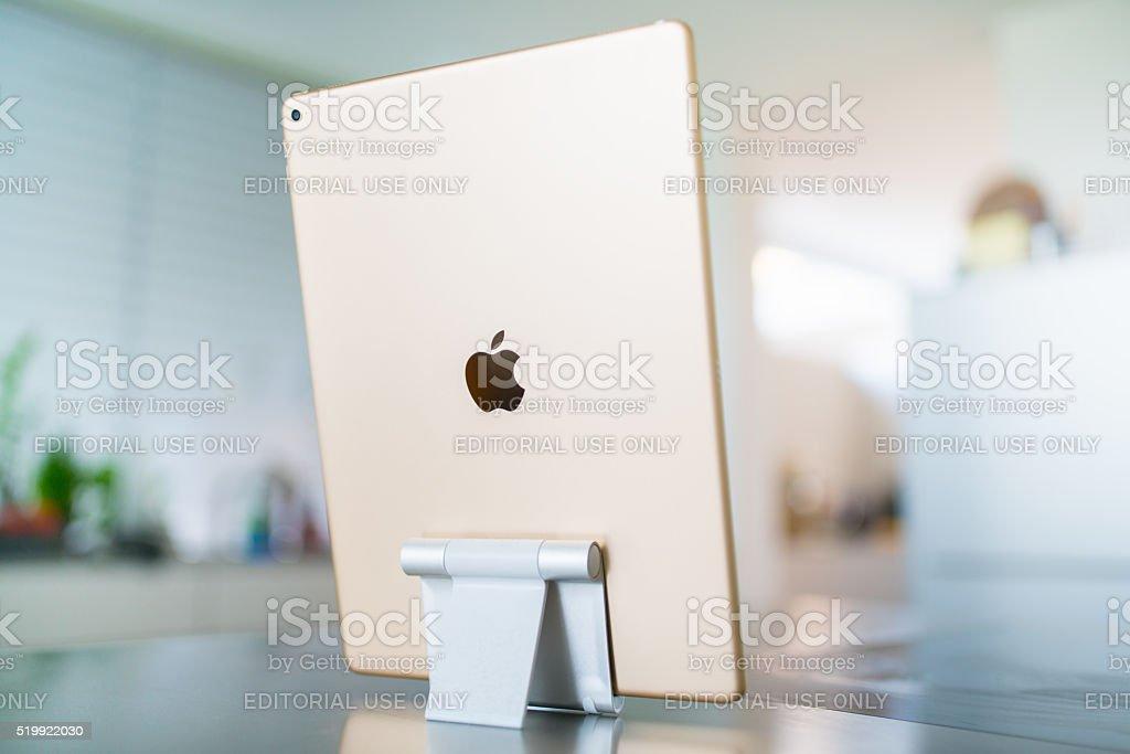 Apple iPad Pro 12.9'  Gold in Modern Living Room stock photo