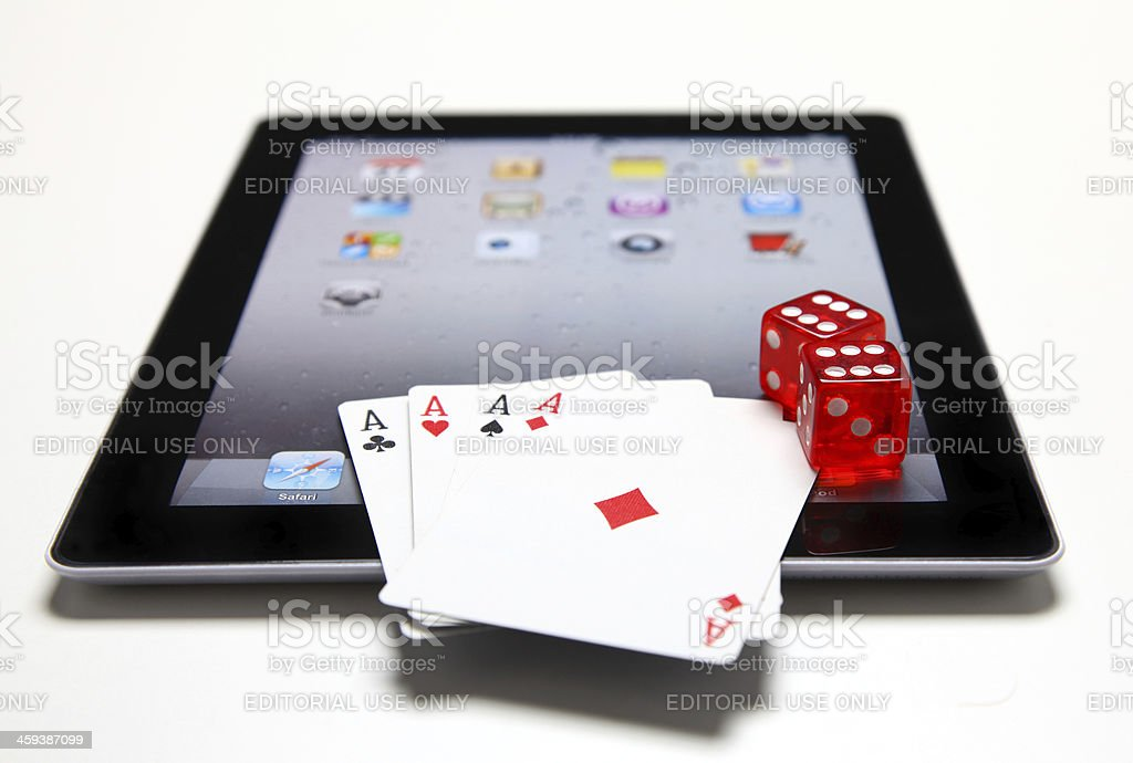 Apple iPad with gambling dice and cards royalty-free stock photo