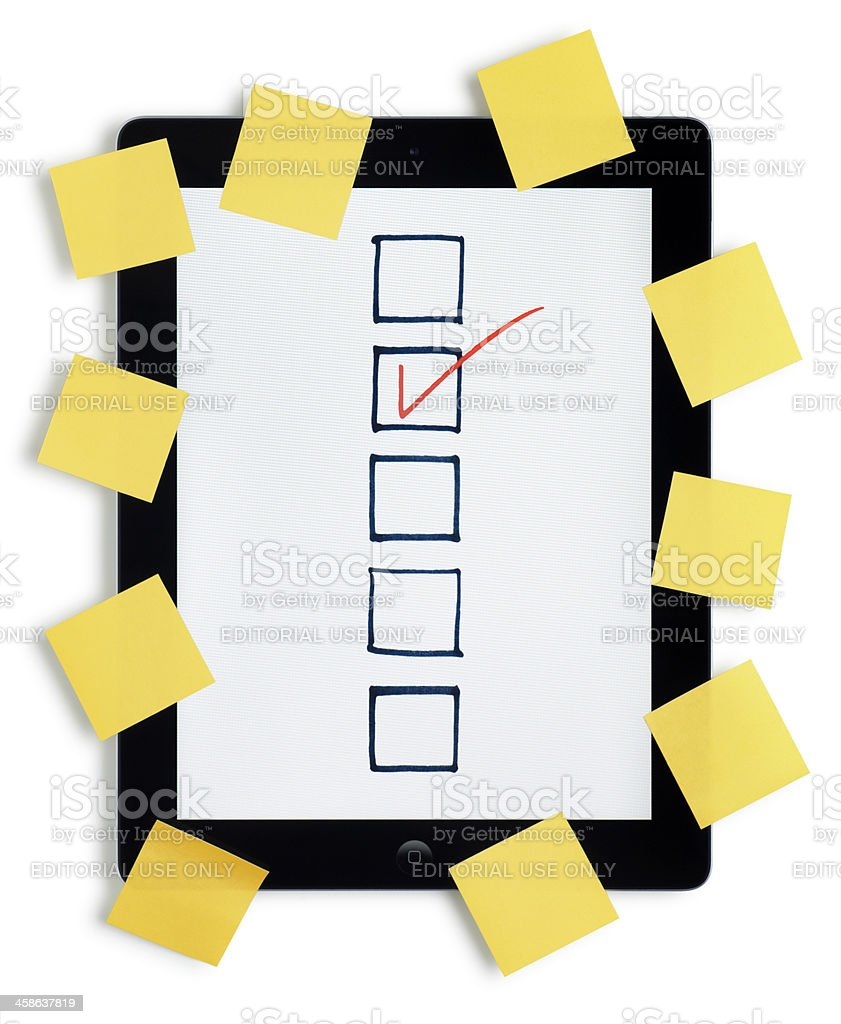 Apple iPad with Yellow Sticky Notes stock photo