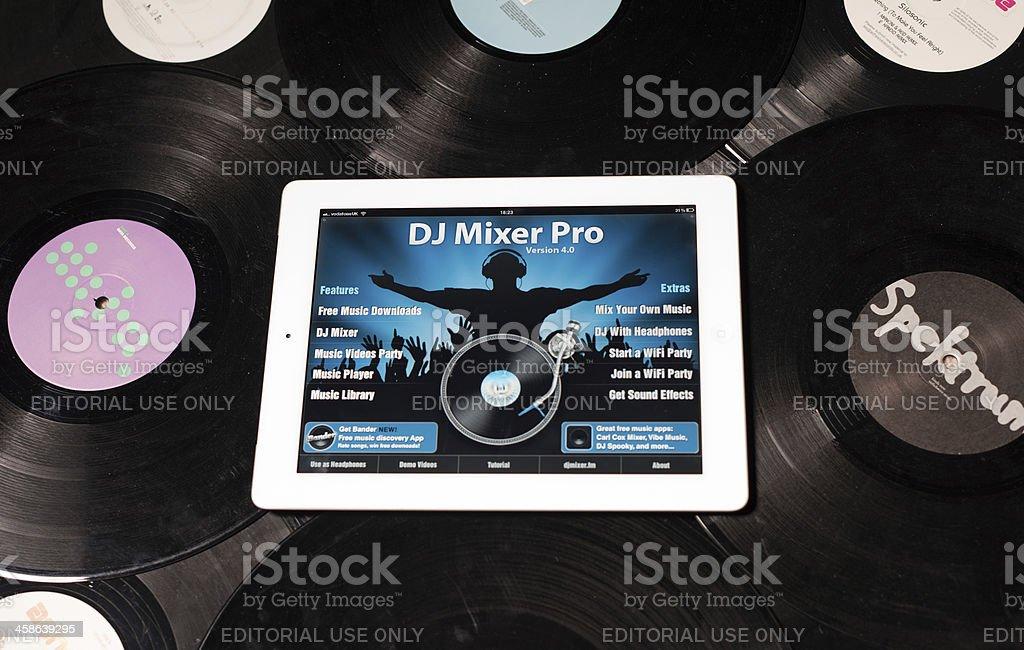 Apple iPad2 on vinyls with DJ Mixer Pro app. royalty-free stock photo