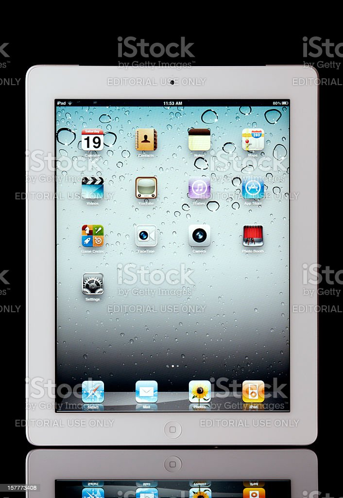 Apple iPad2 Wi-Fi + 3G on Glossy Black Background royalty-free stock photo