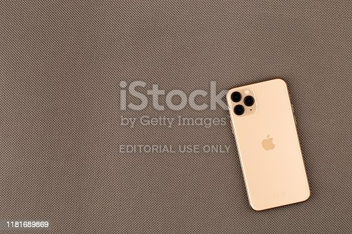 istock Apple iPhone 11 Pro on a grey surface. New smartphone from the company Apple close-up. 1181689869