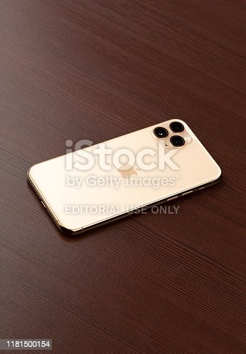 istock Apple iPhone 11 Pro on a wooden surface.  New smartphone from the company Apple close-up. 1181500154