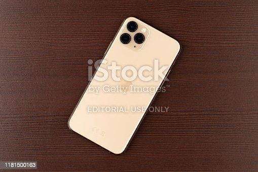 istock Apple iPhone 11 Pro on a wooden surface.  New smartphone from the company Apple close-up. 1181500163