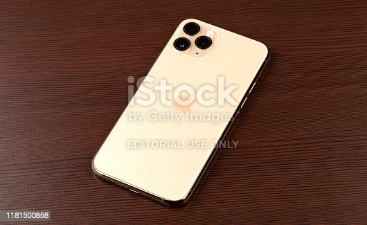istock Apple iPhone 11 Pro on a wooden surface.  New smartphone from the company Apple close-up. 1181500858