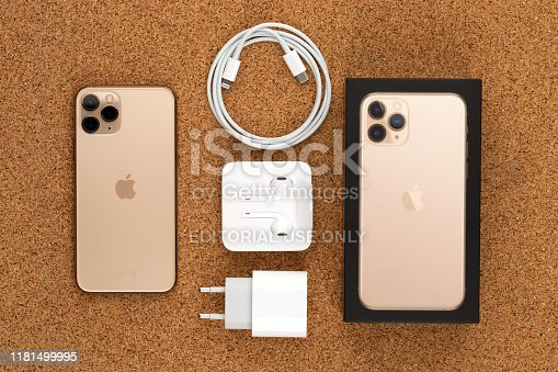 istock Apple iPhone 11 Pro on cork surface. New smartphone from the company Apple close-up. Smartphone and box with a kit from it. 1181499995