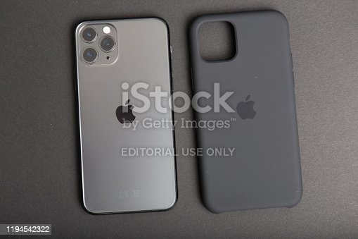 Milan, Italy - December 17, 2019: close up on a brand new Apple iPhone 11 Pro on a black background. Devise in unboxed and a plastic cover lies close to it.