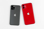 Apple iPhone 11 PRODUCT RED and Apple iPhone 11 Pro Midnight Green on a white background.