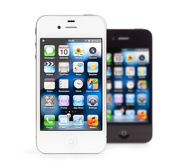 Apple iPhone 4, white and black, isolated stock photo