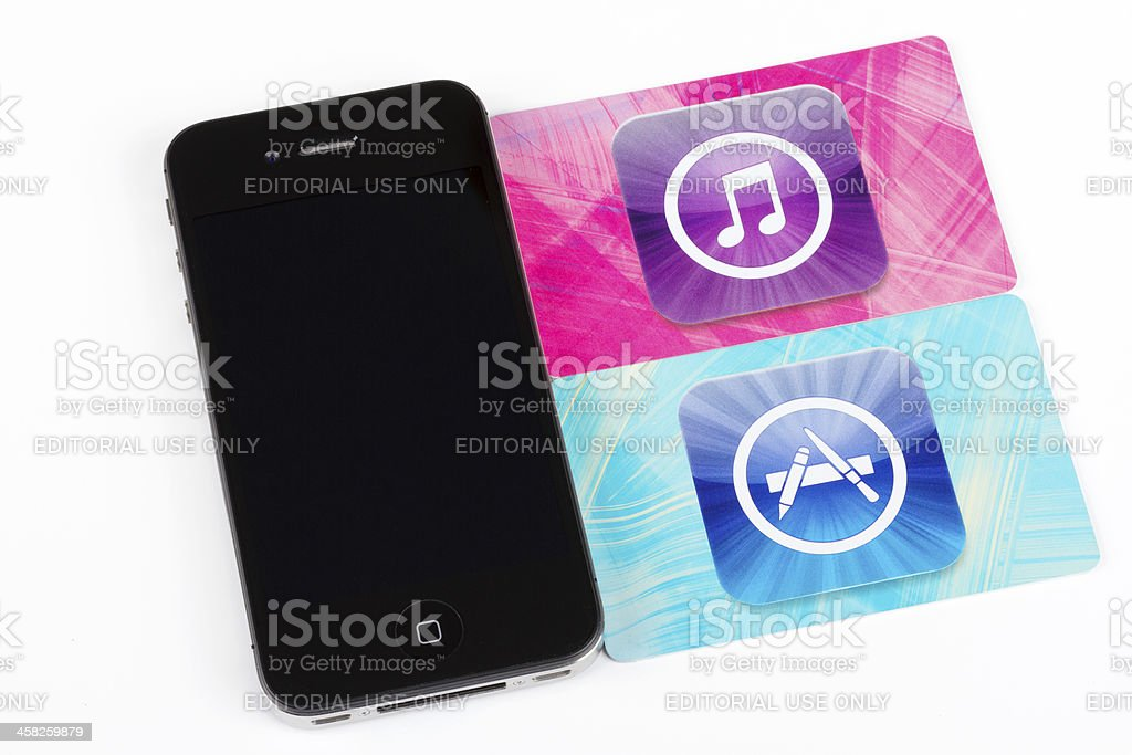 Apple iPhone 4S and iTunes Store cards royalty-free stock photo
