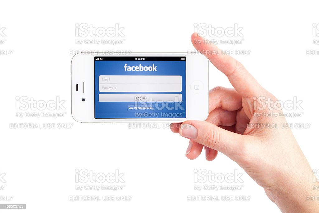 Apple iPhone 4S White with Facebook royalty-free stock photo