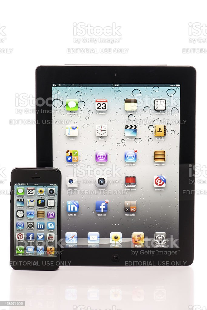 Apple iPhone 5 and iPad Comparison Isolated on White Background royalty-free stock photo
