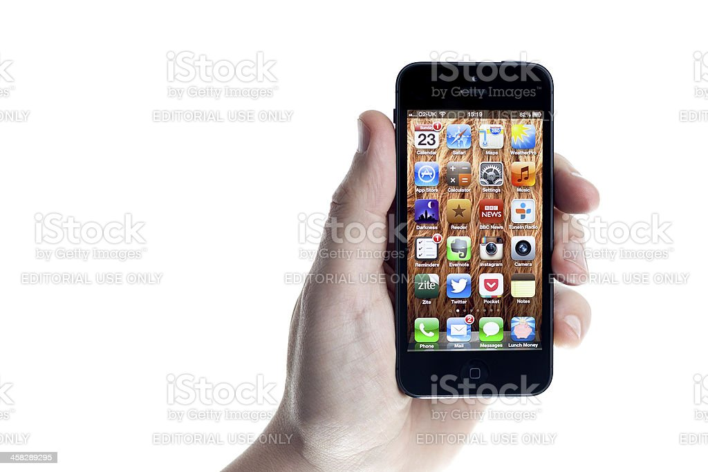 Apple iPhone 5 Held in the Hand on White royalty-free stock photo