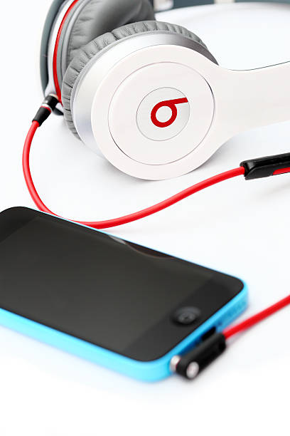 Apple iPhone 5C with Beats Headphones by Dr. Dre stock photo