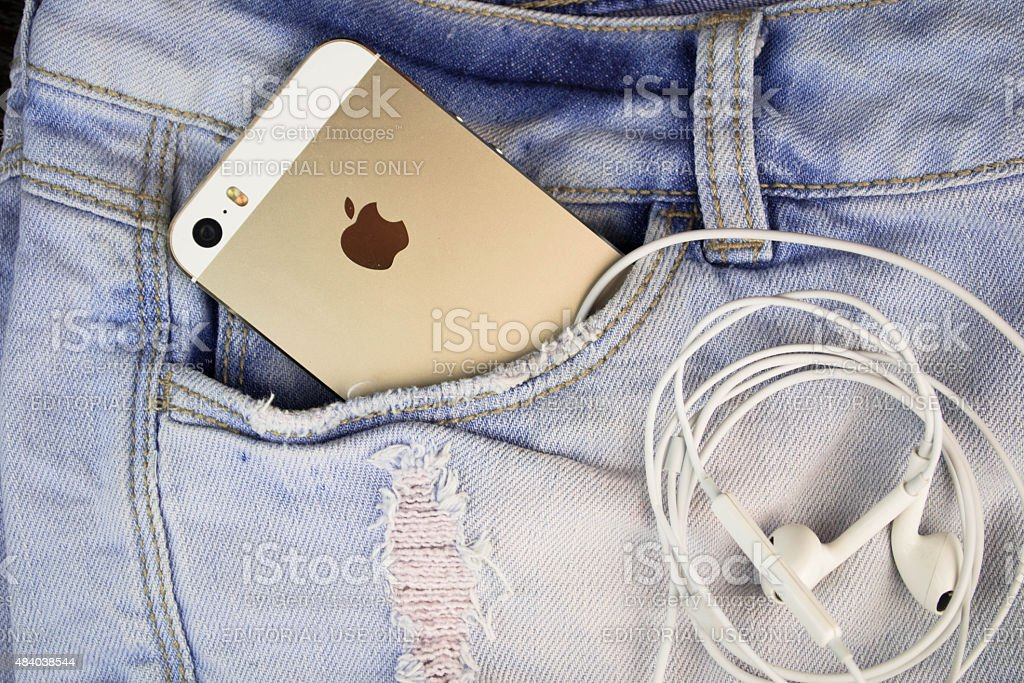 Apple iPhone 5s Gold in a blue denim pocket stock photo