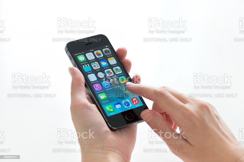 Apple iPhone 5S in hands stock photo
