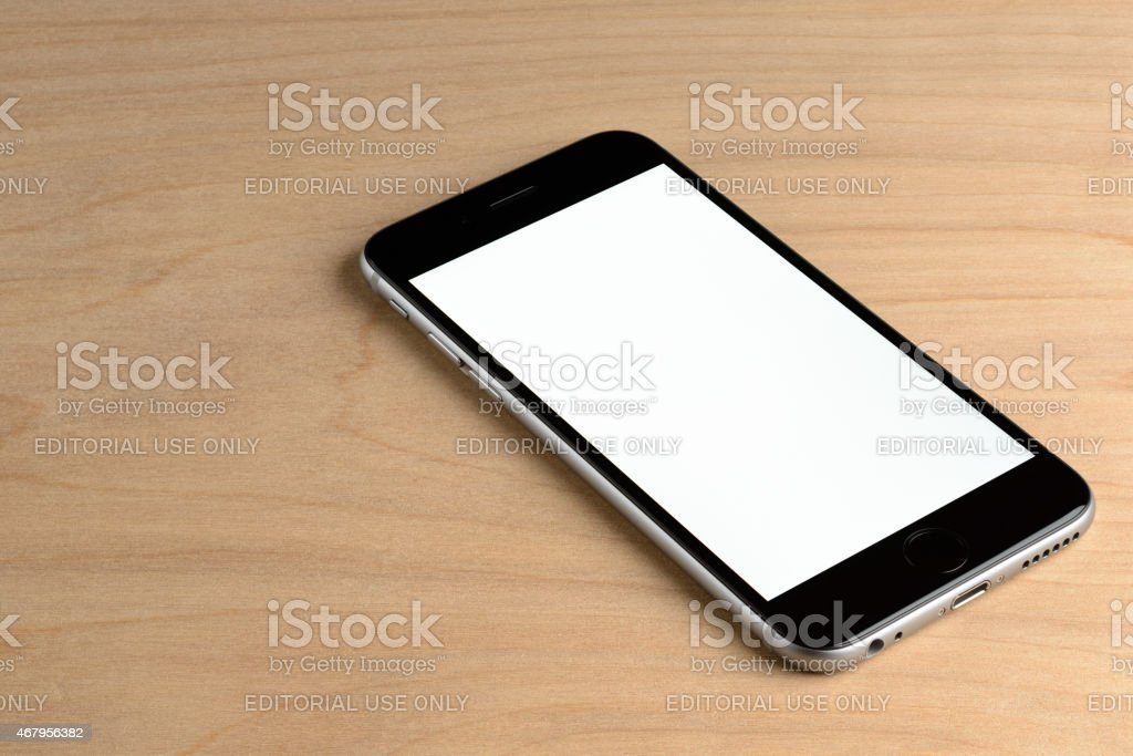 Apple iPhone 6 on a Wood Background stock photo