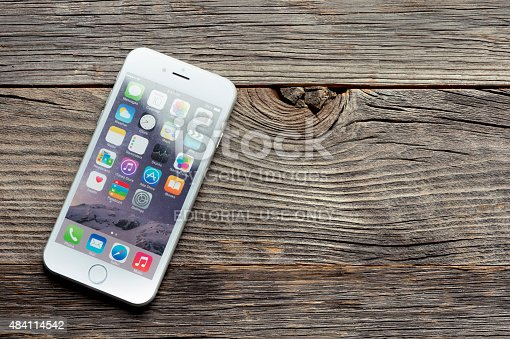 istock Apple iphone 6 on a wooden table or surface. 484114542