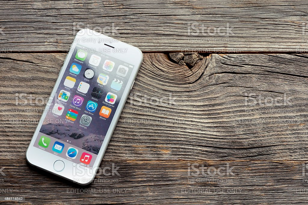 Apple iphone 6 on a wooden table or surface. stock photo
